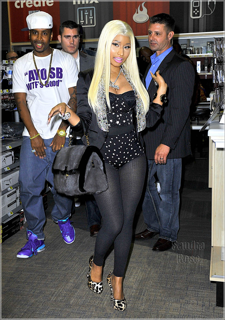 Nicki minaj at best buy for roman reloaded meet greet nicki didnt disappoint wearing a platinum blond wig black leotards a starry body suit under a black satin cropped jacket and animal print pumps m4hsunfo